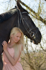 horse and blonde woman