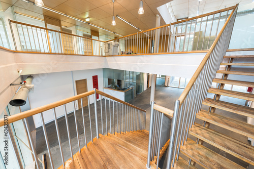 stairway with wooden steps in modern office building