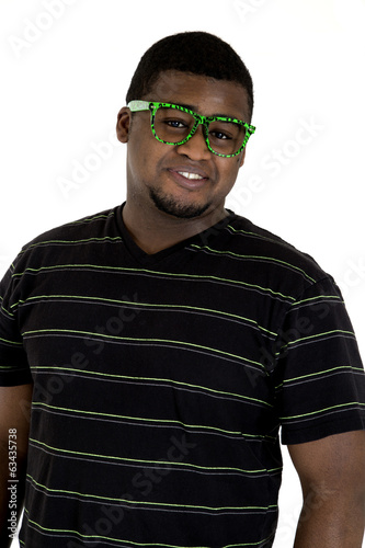 African American male wearing nerdy green glasses smiling