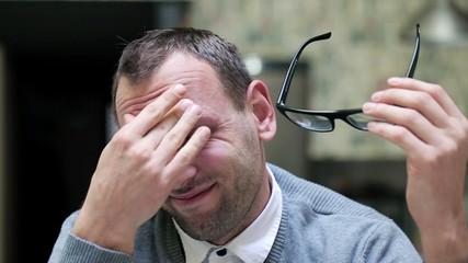 Businessman have headache and feel discomfort, steadycam shot.
