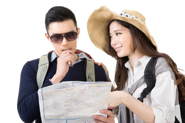 Asian young couple traveling and looking the map