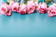 canvas print picture - Pink roses on turquoise blue wooden board
