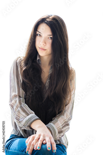 Beautiful brunette girl. Isolated on white.