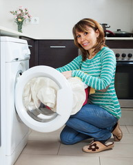 Ordinary housewife using washing machine
