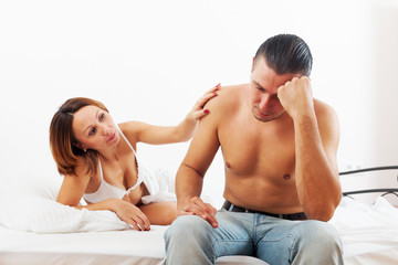 Middle-aged man has problem,  wife comforting him