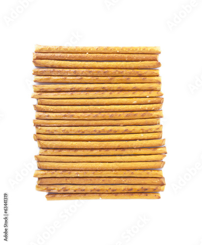 Salted sticks arranged horizontally on white