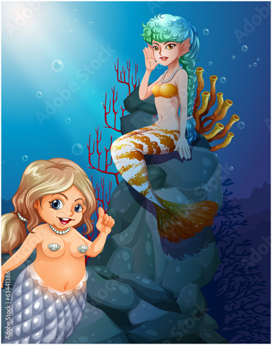Two mermaids under the sea