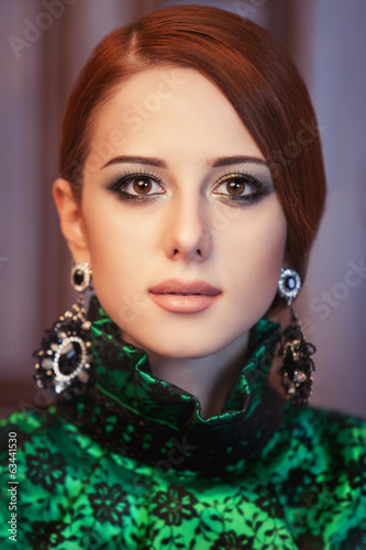 Portrait of a beautiful redhead women with earrings.