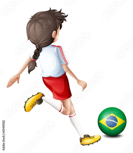 A girl using the soccer ball with the flag of Brazil