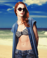 Redhead teen girl on the beach
