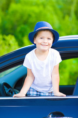 Portrait of cute boy in car
