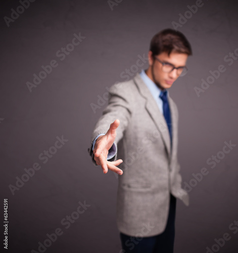 Young man standing and throwing something