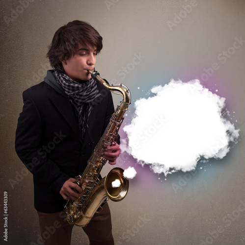 Young man playing on saxophone with copy space in white cloud