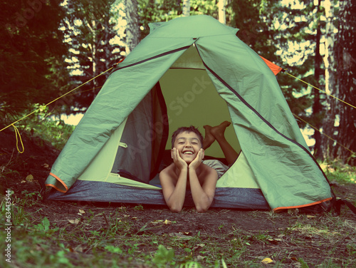 happy boy in camping tent - vintage retro style
