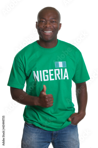 Standing sports fan from Nigeria showing thumb