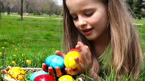 Happy child find easter egg outdoor.