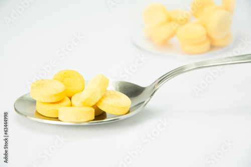 pills on spoon