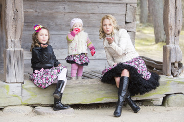 Mother with daughters outdoors
