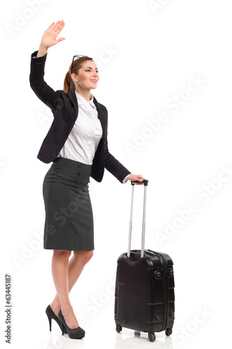 Businesswoman waving hand.