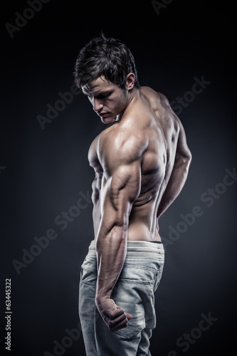 Strong Athletic Man Fitness Model posing back muscles and tricep