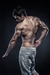 Strong Athletic Man Fitness Model posing back muscles with trice