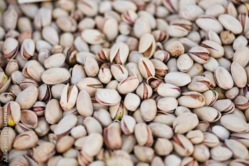 Close up view on pistachios (into nutshells)