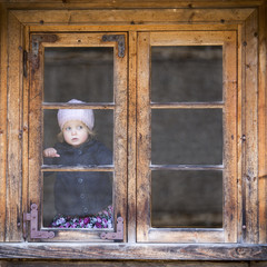 Little girl behind the window