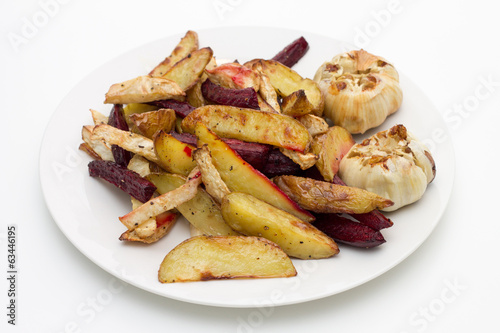 Oven baked potatoes, beetroot, celeriac and garlic bulbs