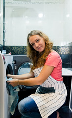 Housework: young woman doing laundry (shallow DOF)