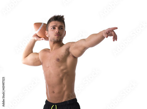 canvas print picture Muscular american football player shirtless ready to throw ball