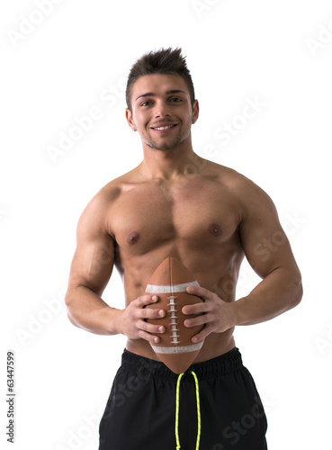 Muscular american football player shirtless with ball in hands