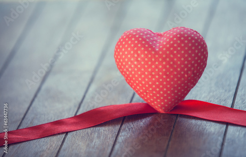 Heart and bow on wooden table