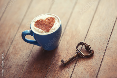 Cup with heart and key.