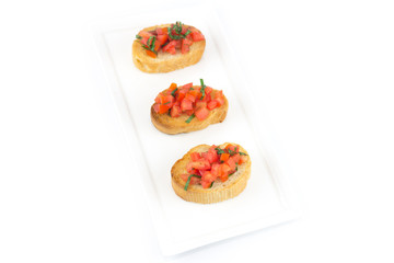 Bruschetta with roasted bell pepper, goat cheese, garlic and her