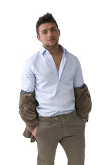 Handsome young man standing with jacket pulled down