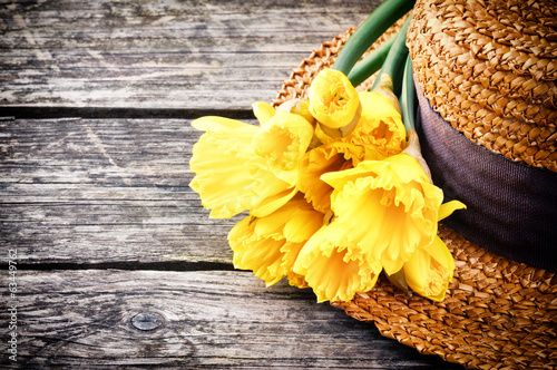 Straw hat with spring flowers