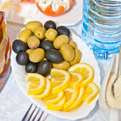olives and lemon slices on a plate