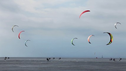colorful snowkite in the sky at winter