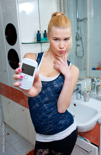 teen girl making selfie in bathroom