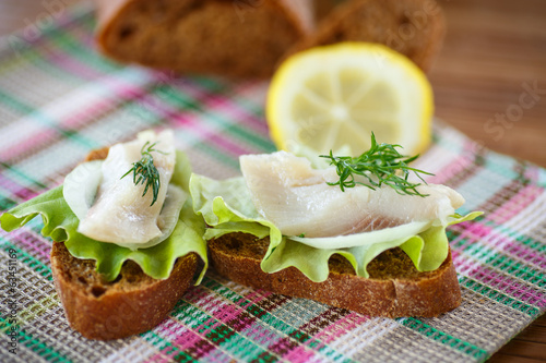 sandwich salted herring and lettuce