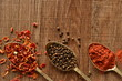 Dry spices in old spoons