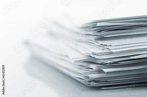 Leinwanddruck Bild Stack of white papers
