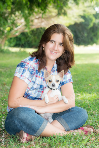 Hispanic woman and her chihuahua pet do
