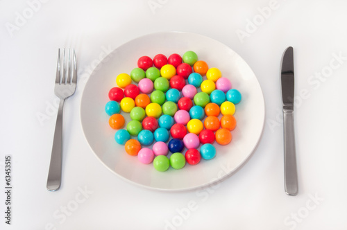 Gum Balls on the Plate with Knife and Fork.