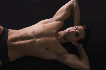 Handsome latin young man naked on floor