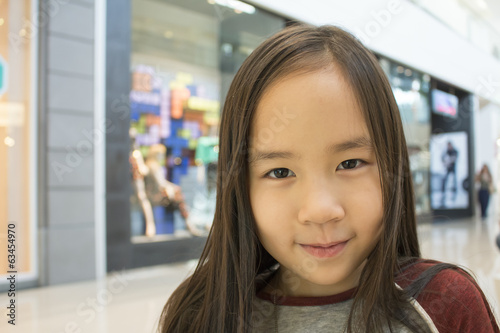 a girl smiling in the shopping mall