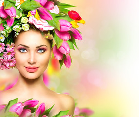 Beauty summer model girl with colorful flowers hairstyle