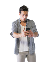 Young man looking at cell phone with angry expression