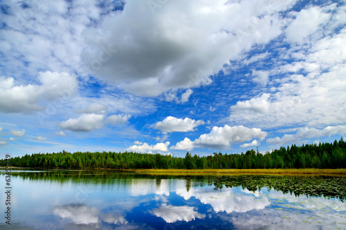 Lake Engozero and dramatic clouds. North Karelia, Russia