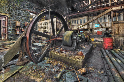 Staande foto Industrial geb. Old machinery in derelict workshop
